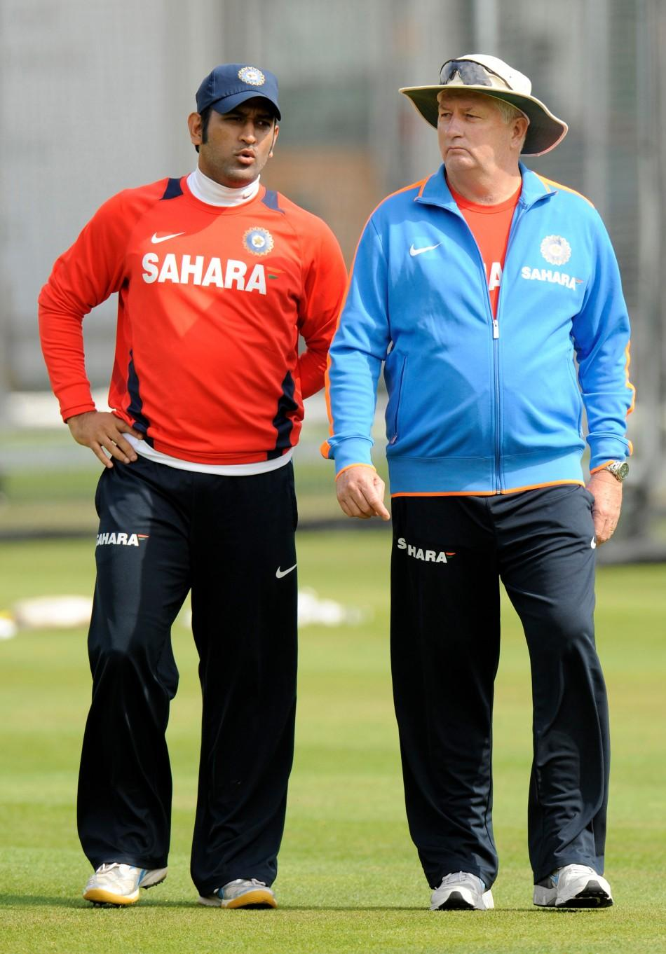 India's Dhoni talks to Fletcher during a training session before Thursday's first cricket test match against England at Lord's.
