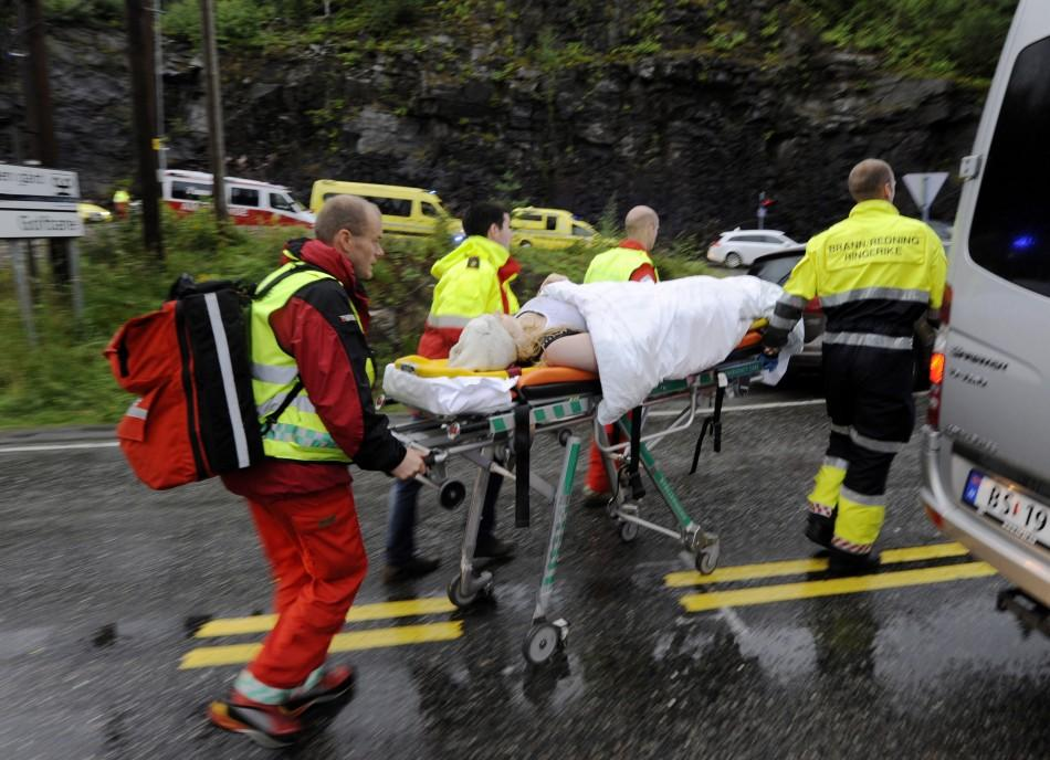 Rescue personnel push an injured youth on a stretcher in Storoya