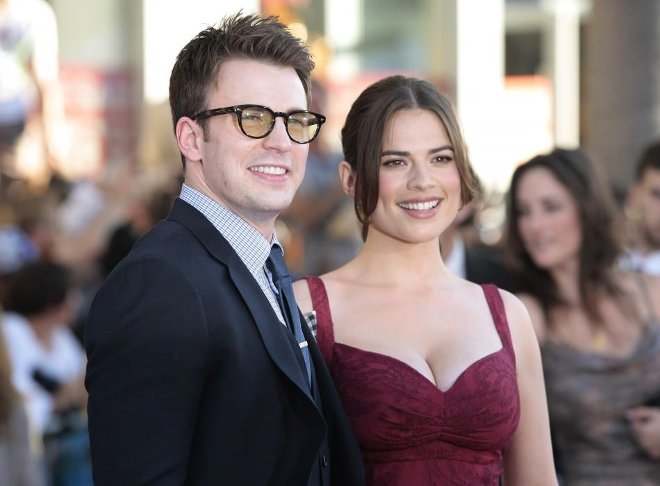 """Evans and Atwell pose as they arrive at the """"Captain America: The First Avenger"""" film premiere in Hollywood"""