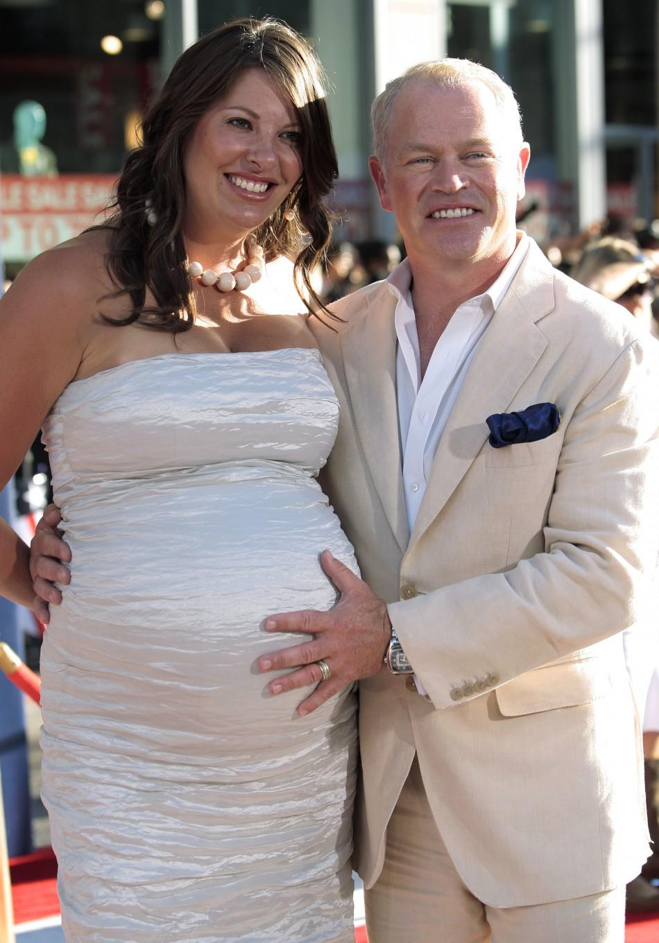 "Cast member McDonough and his wife arrive at the ""Captain America: The First Avenger"" film premiere in Hollywood"