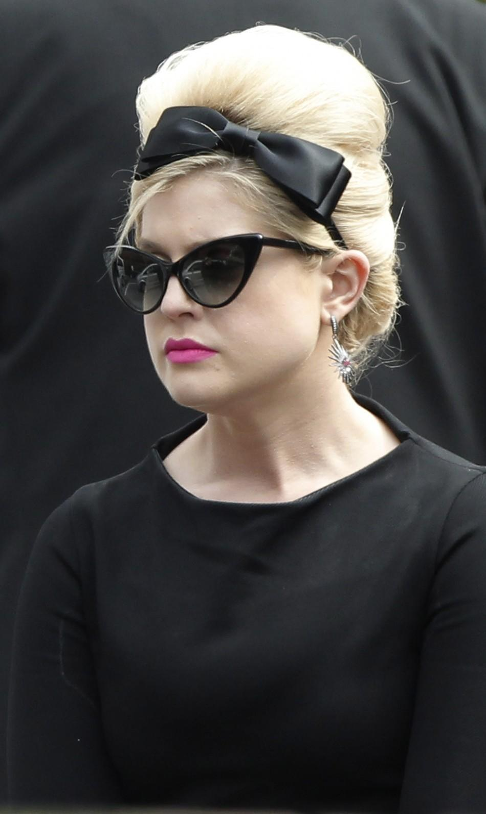 Kelly Osbourne leaves Golders Green Crematorium after the cremation of British singer Amy Winehouse, in north London 26/07/2011