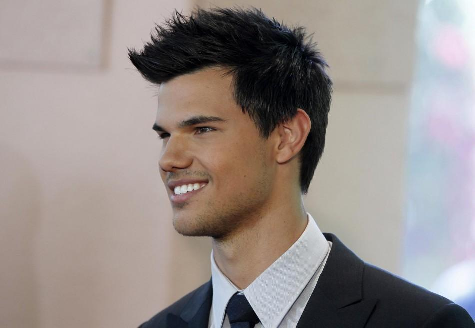 Actor Taylor Lautner arrives at the Hollywood Foreign Press Association annual installation luncheon in Beverly Hills.