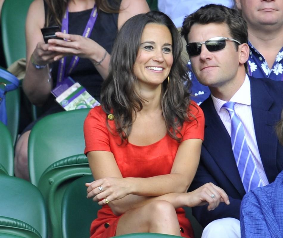 The sister of Catherine, Duchess of Cambridge, Pippa Middleton and former English cricketer, Alex Loudon, sit on Centre Court at the Wimbledon tennis championships in London