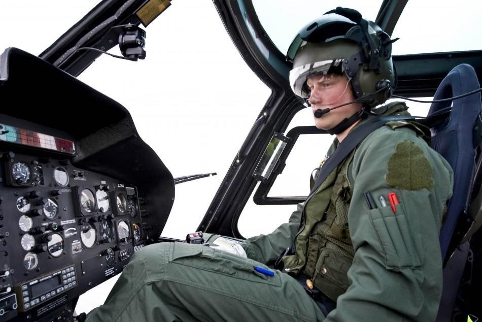 Handout photograph shows Britain's Prince Harry posing for the photographer at RAF Shawbury near Shrewsbury