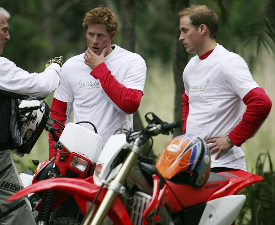 Britain's Prince William and Prince Harry talk to co-organiser Mike Glover as they stand with their motorcycles before the start of the the Enduro Africa 08 charity motorcycle ride in Port Edward
