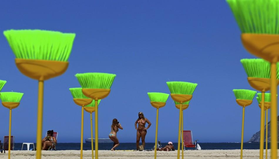 Brazilians Urge to 'Sweep off' Corruption by Placing Brooms at a Beach