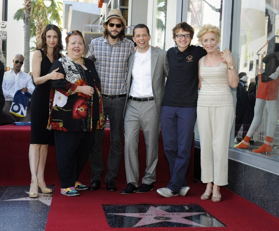 "Jon Cryer (3rd R) poses with his TV series ""Two and a Half Men"" co-stars (L-R) Marin Hinkle, Conchata Ferrell, Ashton Kutcher, Angus T. Jones and Holland Taylor during a ceremony honoring Cryer with a star on the Hollywood Walk of Fame in Los An"