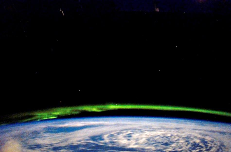 While docked and onboard the International Space Station, a STS-123 Endeavour crew member captures the glowing green beauty of the Aurora Borealis