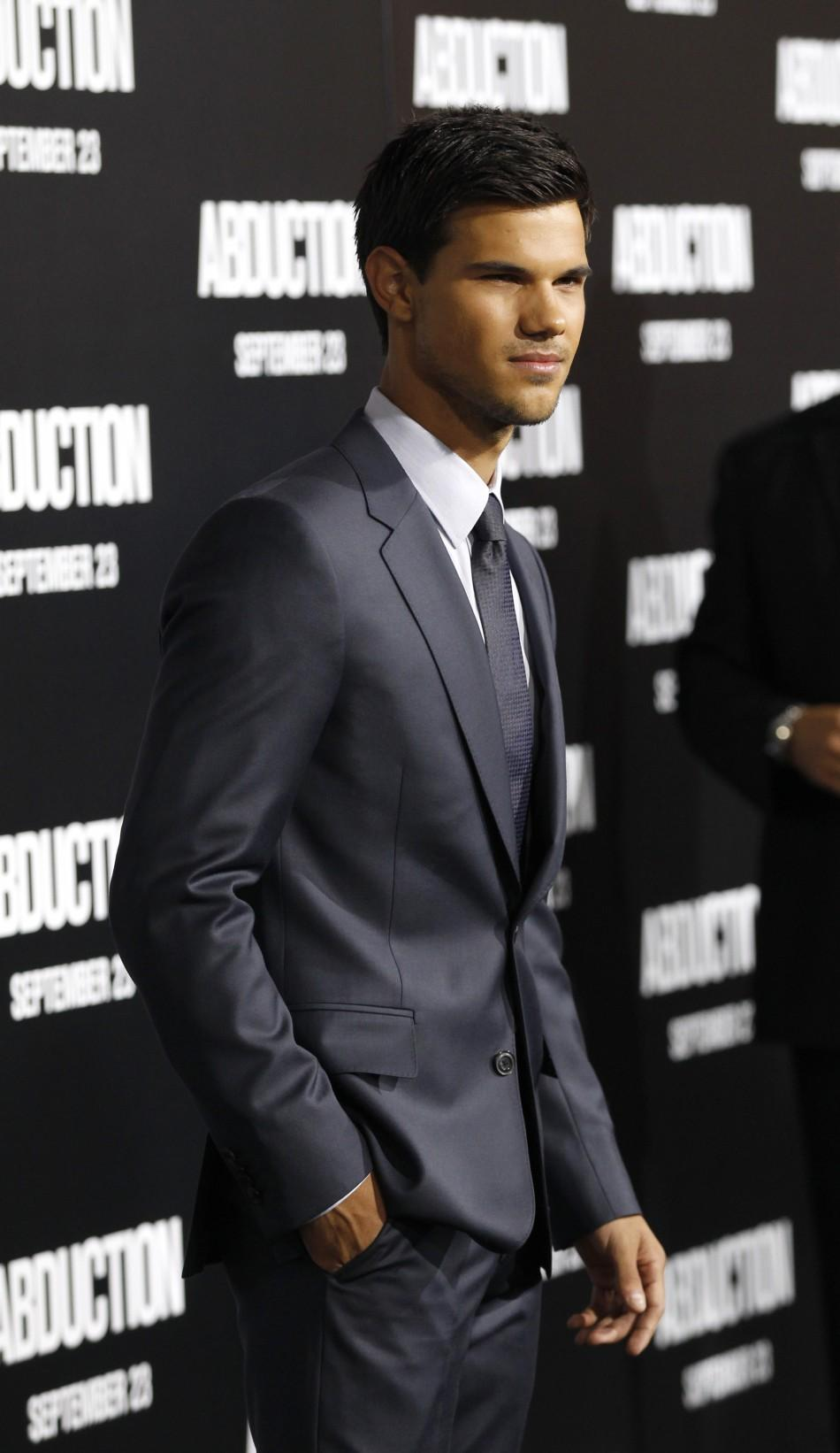 "Taylor Lautner poses during the world premiere of ""Abduction"" in Hollywood"
