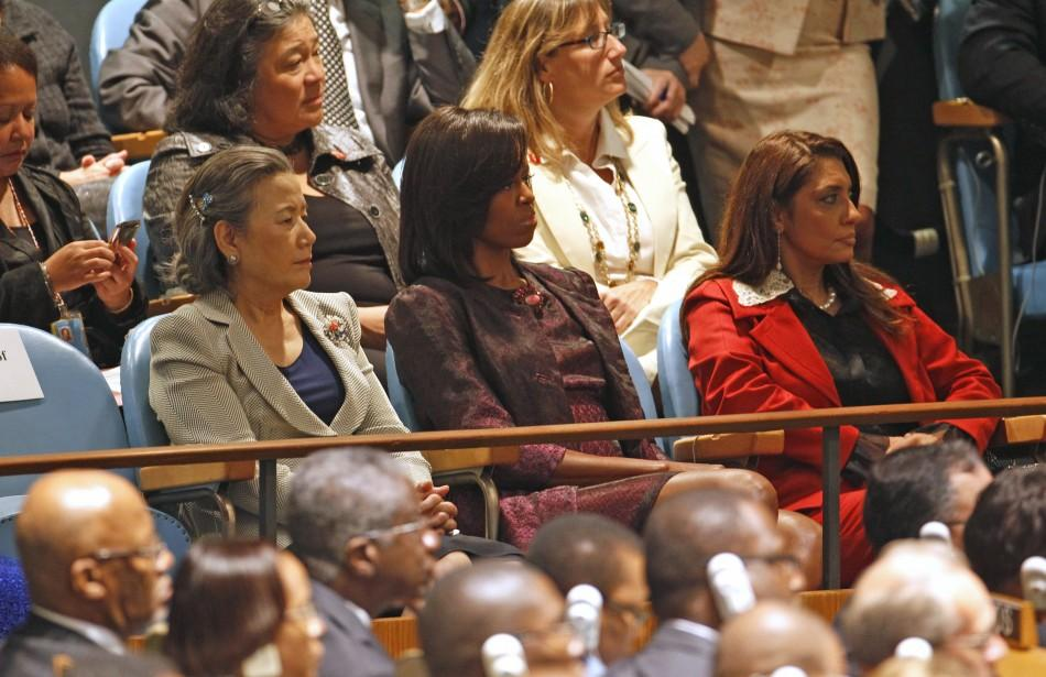 U.S. first lady Michelle Obama (C) listens to U.S. President Barack Obama as he addresses the 66th United Nations General Assembly at U.N. headquarters in New York, September 21, 2011.