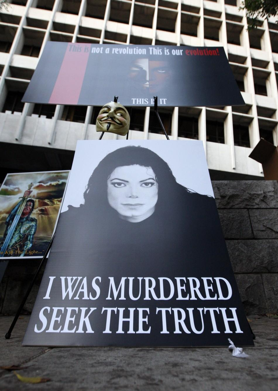 Placards are seen outside the Los Angeles Superior Court during the opening day of Dr. Conrad Murray's trial in the death of Michael Jackson