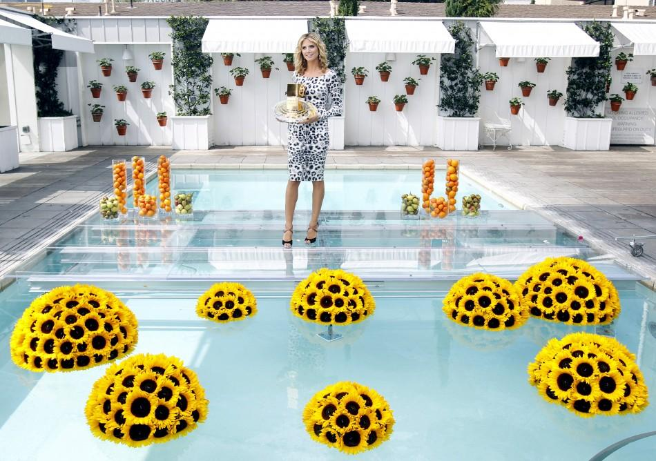 "German model Heidi Klum poses during the launch of her new fragrance ""Shine"" in west Hollywood, California"