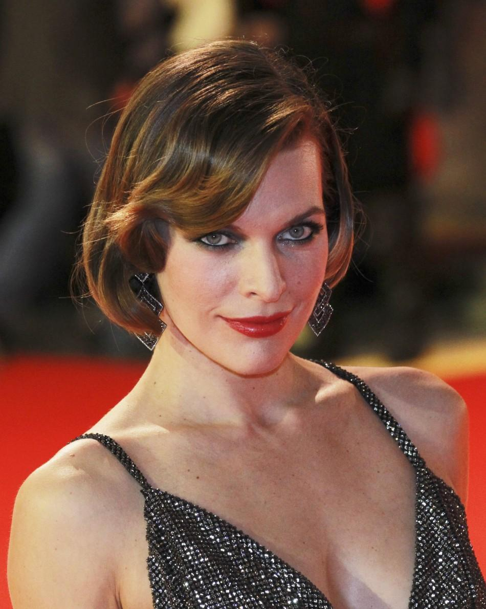 """Actress Milla Jovovich poses for fotos at the world premiere of """"The Three Musketeers"""" at Westfield, London"""
