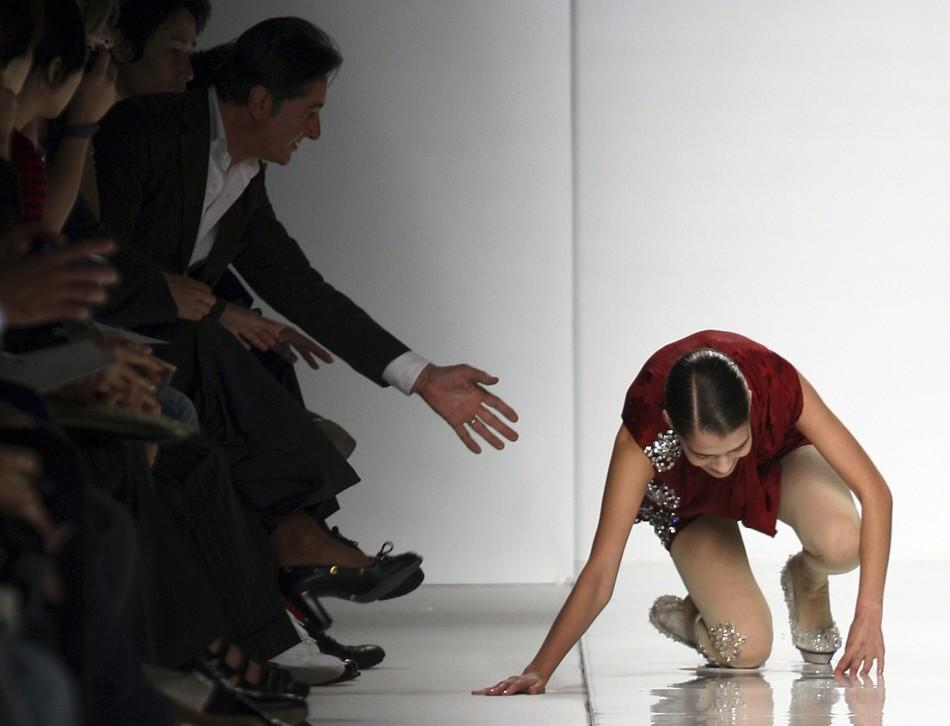 A model falls as she displays a creation as part of Mila Schon Spring/Summer 2010 women's collection during Milan Fashion Week