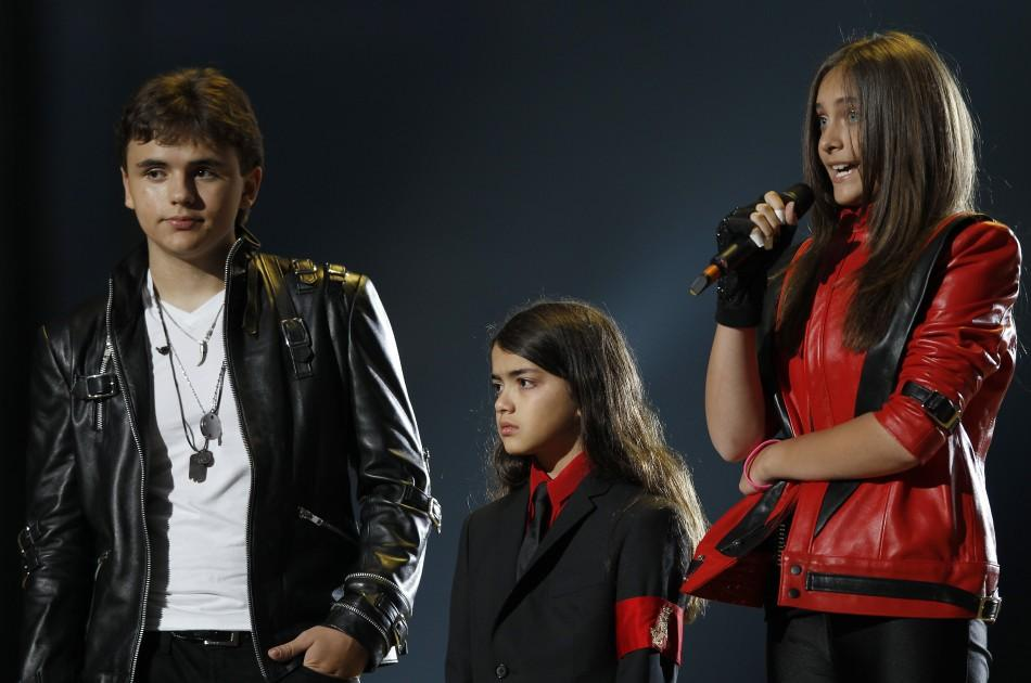 "The children of late singer Michael Jackson, Prince Michael Joseph Jackson Jr., Prince Michael Jackson II (Blanket) and Paris-Michael Katherine Jackson (L-R) stand on stage during the ""Michael Forever"" tribute concert, which honours late pop ico"