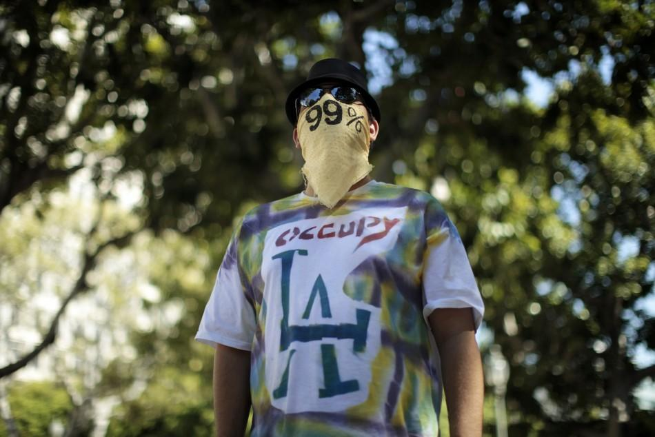 A man wears an Occupy LA t-shirt at their protest camp in Los Angeles, California