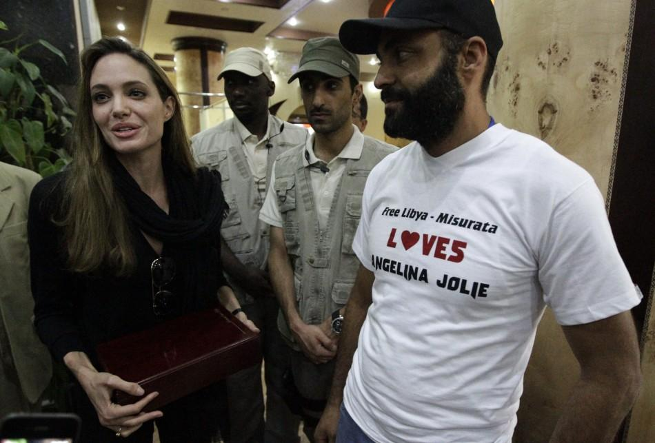U.S. actress and UN Goodwill Ambassador Angelina Jolie receives a plaque from residents during her visit to the war-torn city October Misrata