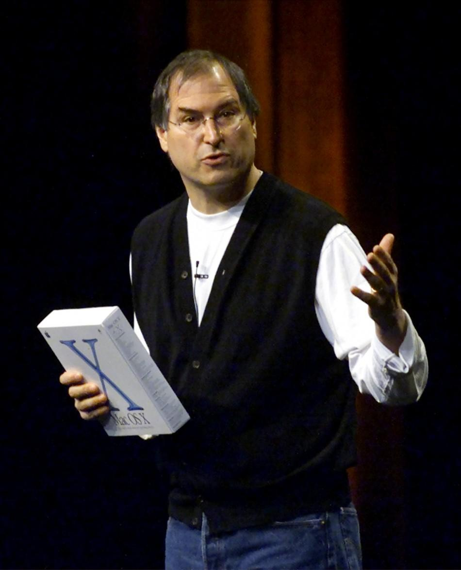 Apple Computer CEO Steve Jobs holds a box containing Apple's new Mac OS X operating system while giving the keynote address at the Apple Worldwide Developers Conference in San Jose, California, May 21, 2001