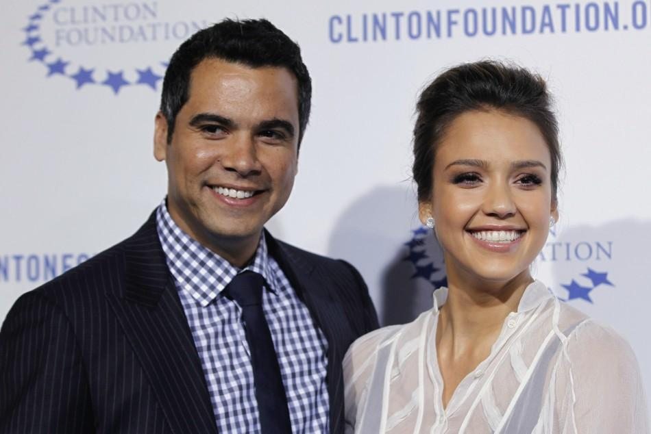 "Actress Jessica Alba (R) and her husband Cash Warren arrive at The Clinton Foundation Gala in celebration of the organization's ""Decade of Difference"" in Los Angeles"