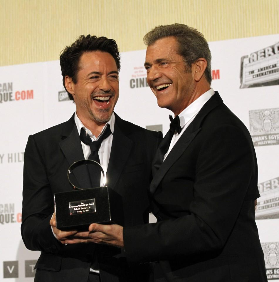 Actor Mel Gibson (R) presents actor Robert Downey Jr. with the 25th American Cinematheque Award during a mock presentation for the media in Beverly Hills, California