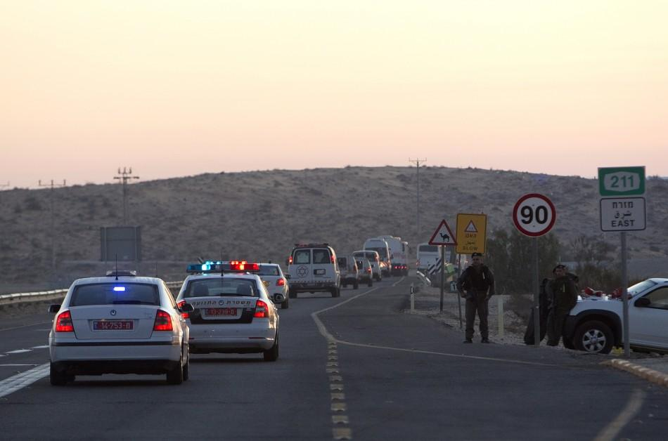 A convoy carrying Palestinian prisoners is seen as it leaves the Ketziot prison in southern Israel October 18, 2011.