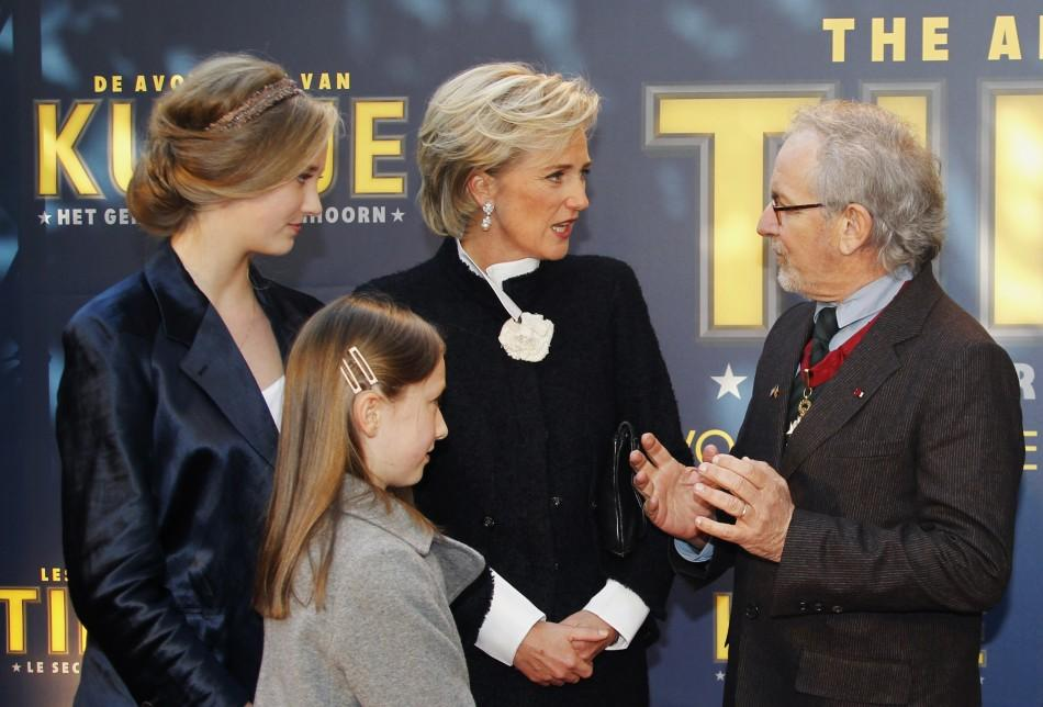 "Director Steven Spielberg talks to Belgium's Princess Astrid (2nd R) and her daughters Luisa Maria (L) and Laetitia Maria (2nd L) during a photocall ahead of the world premiere of the movie ""The Adventures Of Tintin: The Secret of The Unicorn&qu"