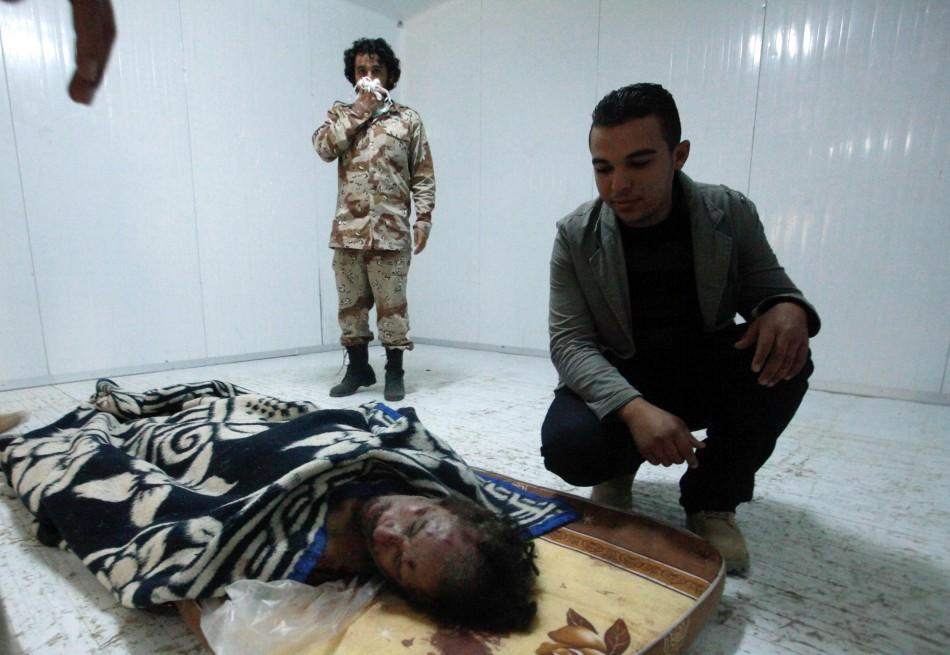 The body of Muammar Gaddafi is seen inside a cold metal storage container in Misrata