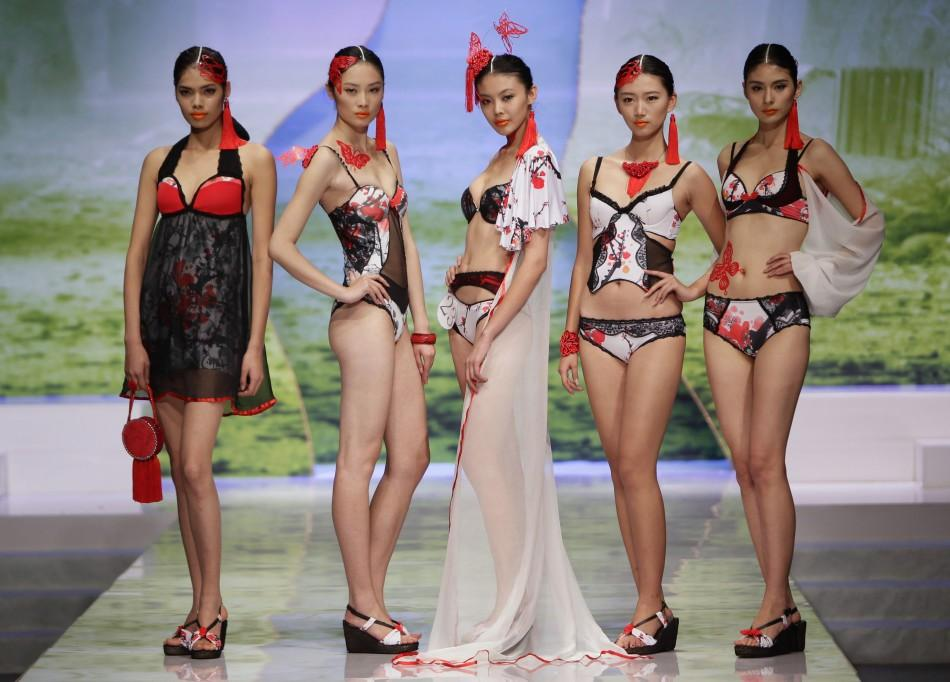 "Models present creations for the ""Ordifen Cup,"" a lingerie design contest, during China Fashion Week for Spring/Summer 2012 in Beijing October 26, 2011"