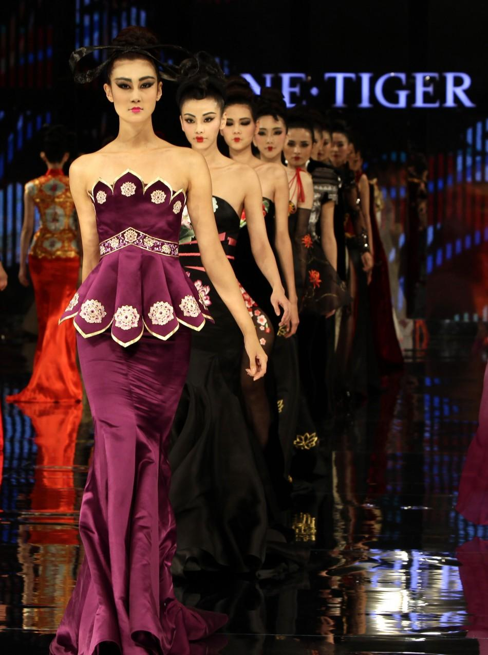 "Models present creations for the NE TIGER 2012 Haute Couture collection with the theme ""Tang Dynasty"" (618-907) during China Fashion Week for Spring/Summer 2012 in Beijing October 25, 2011"