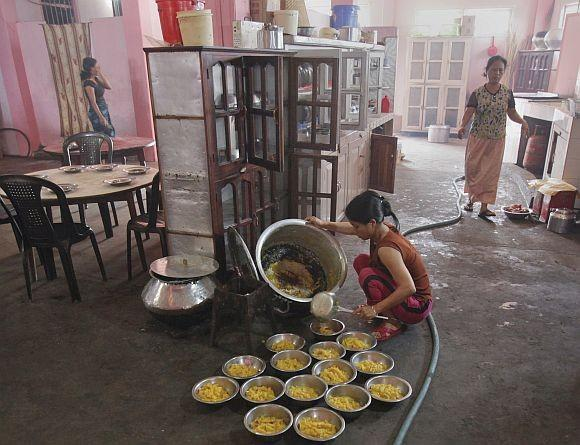 A wife of Ziona prepares breakfast at their residence