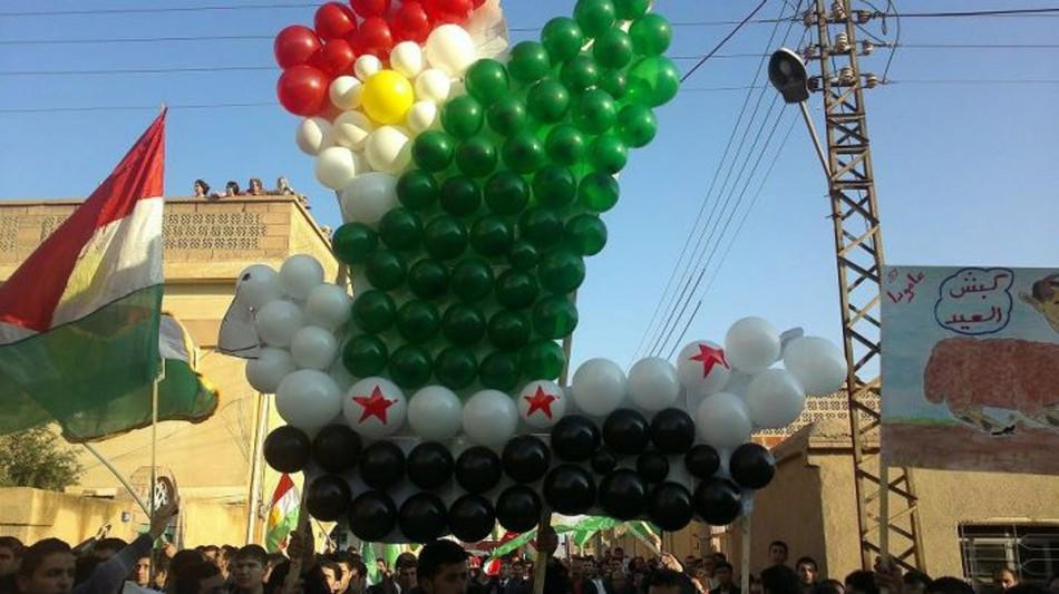 Demonstrators protesting against Syria's President Bashar al-Assad march through the streets will balloons on the first day of the Muslim festival of Eid-al-Adha in Alsnmin near Daraa November 6, 2011.