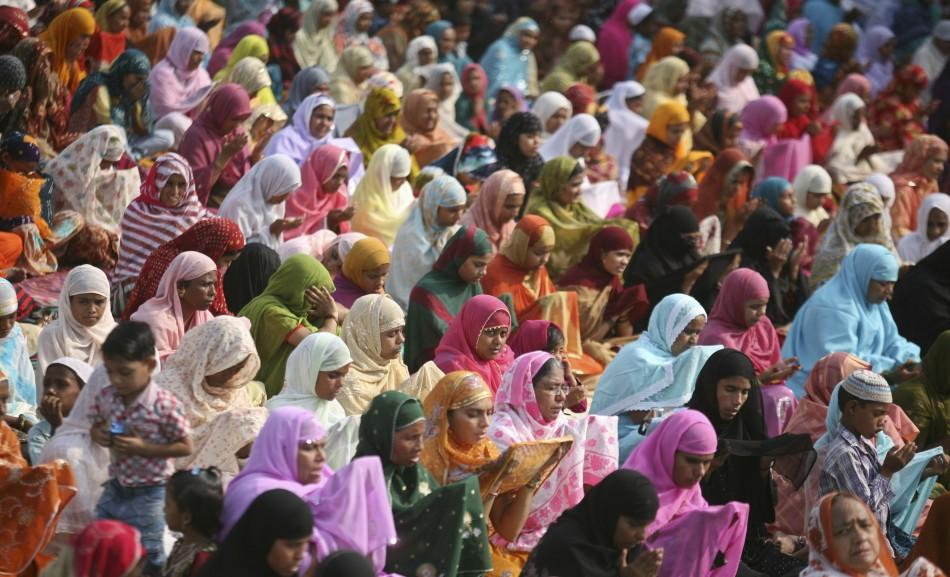 Muslim women offer prayers at a mosque on the eve of the Eid al-Adha festival on the outskirts of the western Indian city of Ahmedabad November 6, 2011.