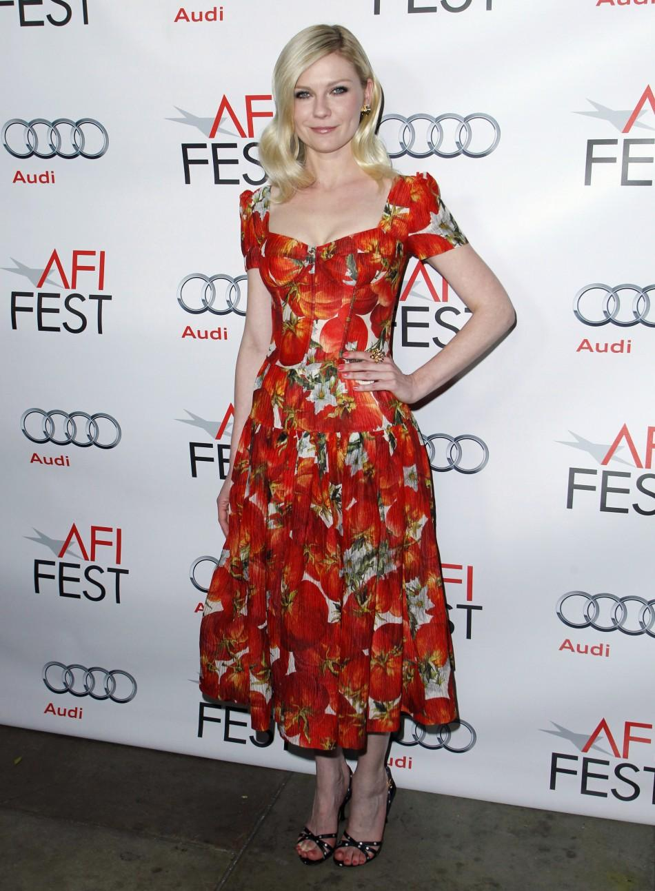 "Cast member Kirsten Dunst poses at a screening of the film ""Melancholia"" during AFI Fest 2011 in Hollywood"