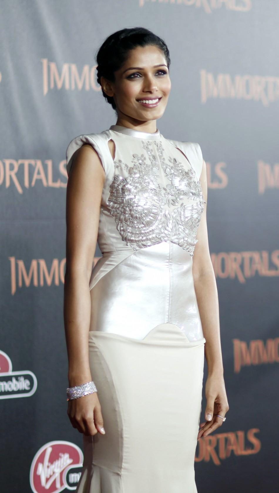 "Cast member Freida Pinto poses at the world premiere of ""Immortals"" at the Nokia theatre in Los Angeles"