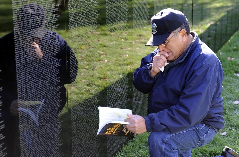 Amos Cortez at the Vietnam Wall.