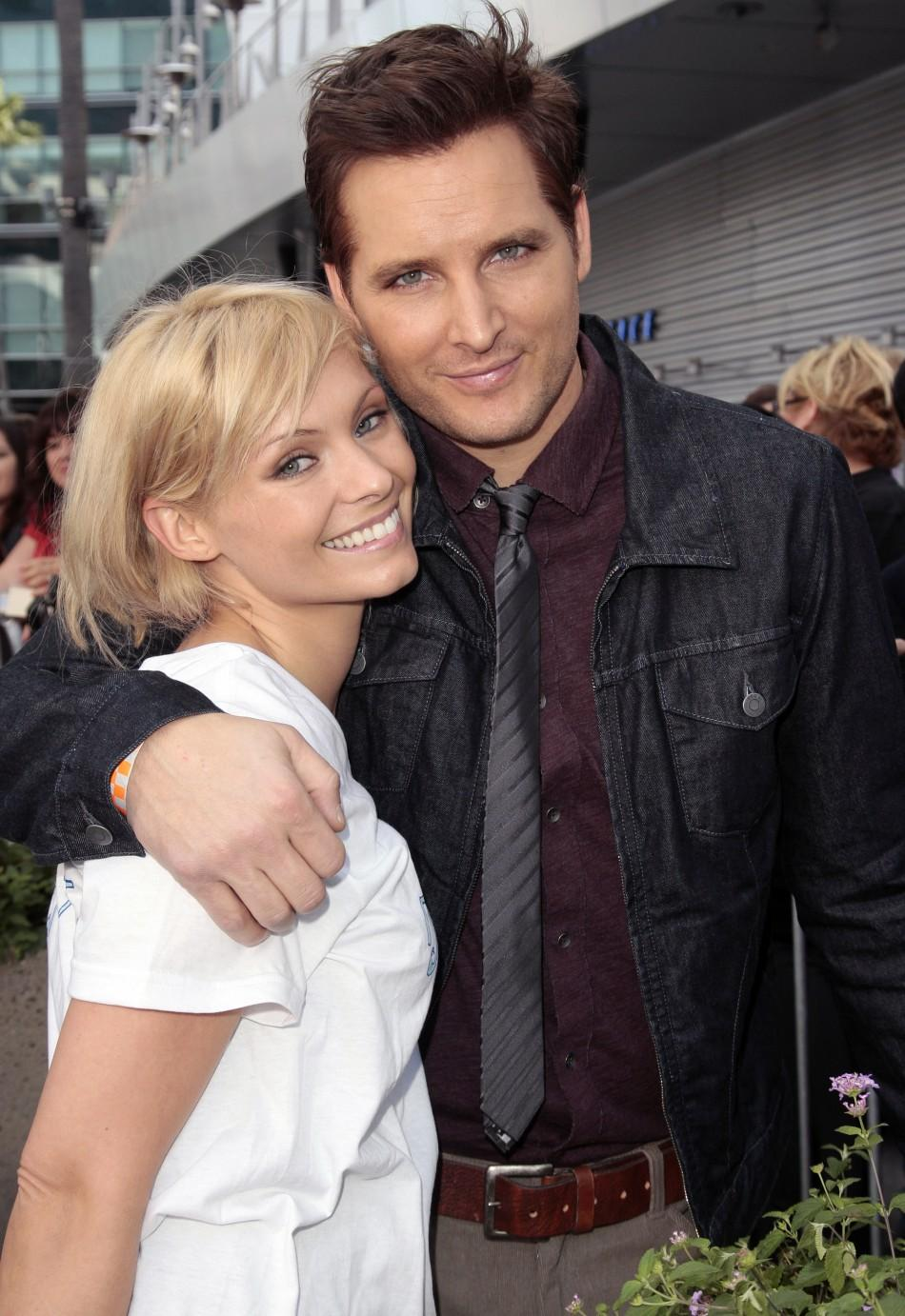"""Actors Peter Facinelli (R) and MyAnna Buring pose as several cast members visit fans camping out for the premiere of """"The Twilight Saga: Breaking Dawn Part - 1"""" in Los Angeles, California"""