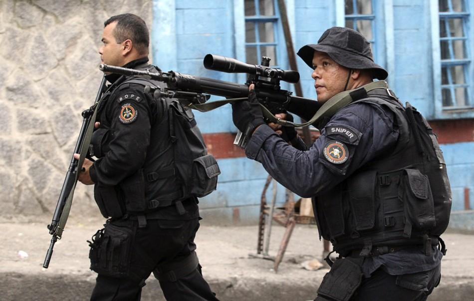 "Policemen patrol the Rocinha slum during the ""Shock of Peace"" operation to install Peacekeeping Unit (UPP) in Rio de Janeiro November 13, 2011"