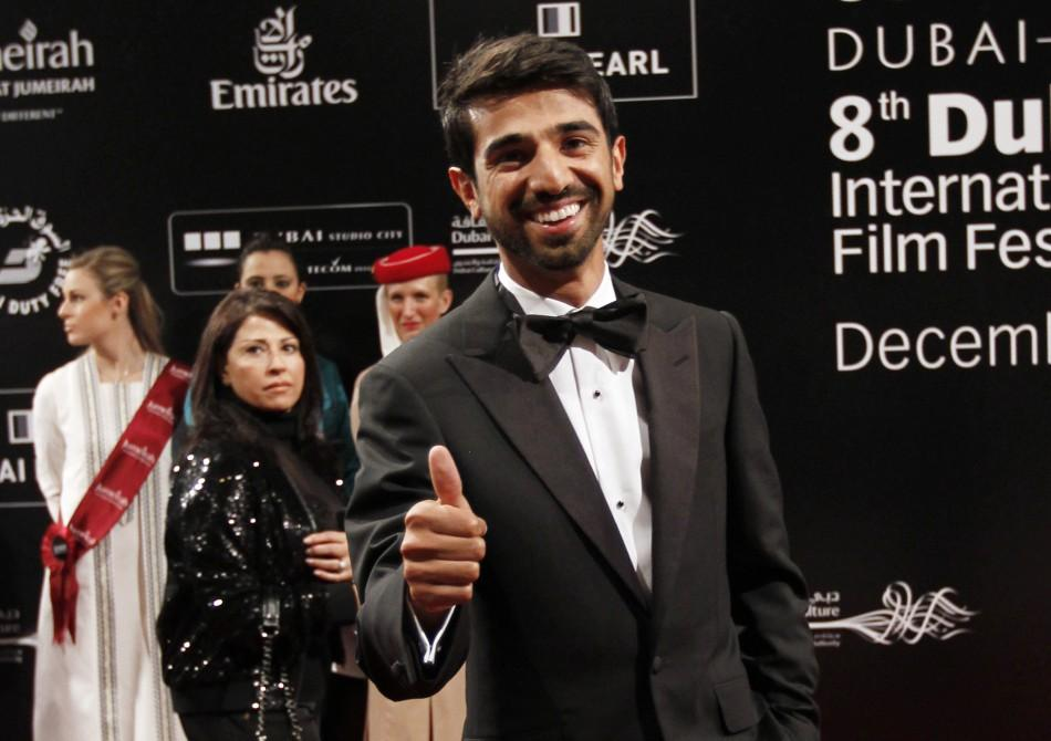 Emirati film director Abdulla Al Kaabi gestures as he arrives for the opening ceremony of the 8th Dubai International Film Festival