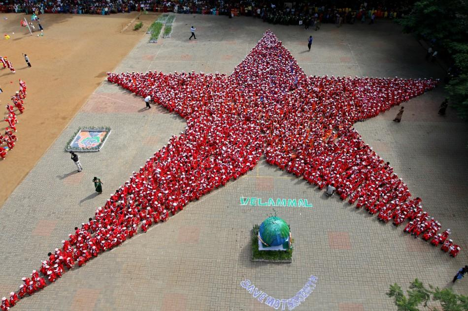 Schoolchildren dressed as Santa Claus form the shape of a star ahead of Christmas celebrations at a school in the southern Indian city of Chennai December 10, 2011. Some 1500 schoolchildren aged three to five formed the shape of a Christmas star on Saturd