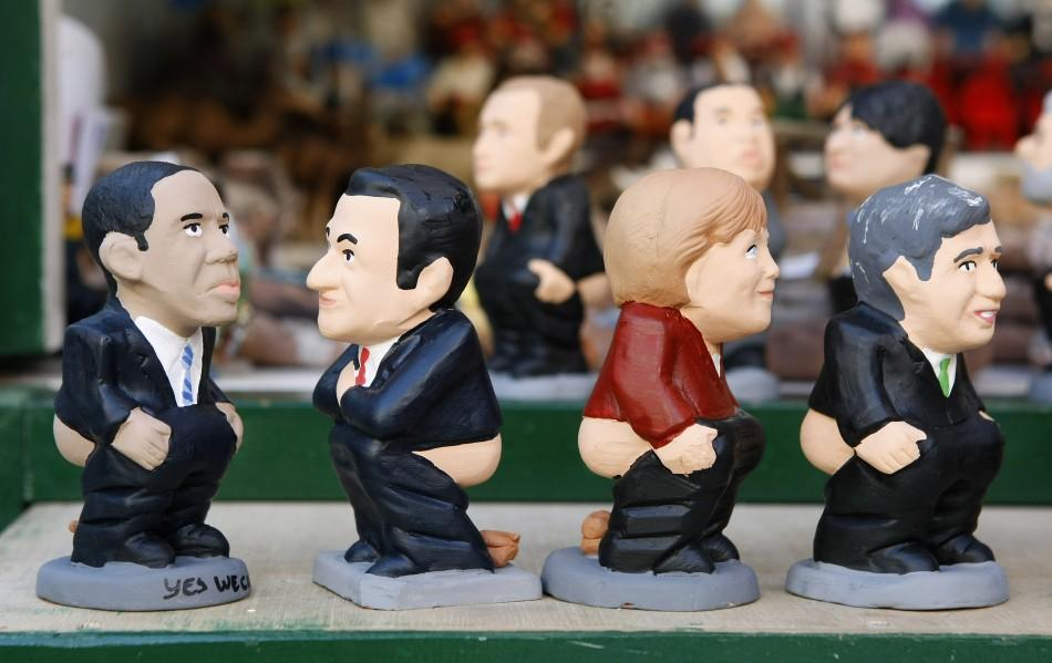 "Figurines known as ""caganer"", of political leaders are sold at the Santa Llucia Christmas market"