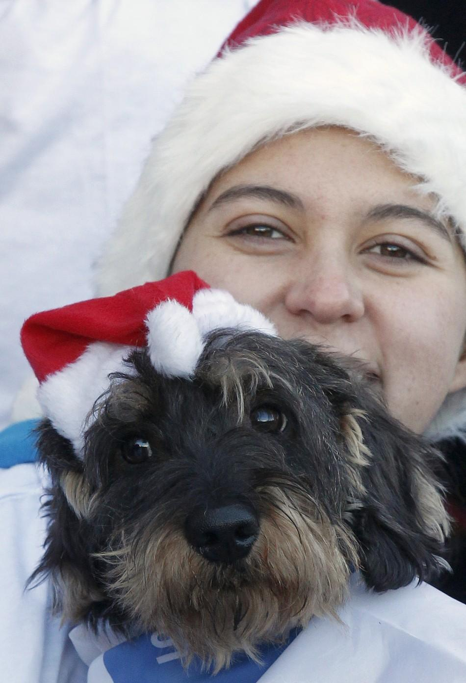 """A woman poses with her dog before the start of the """"Sanperrestre"""" race in central Madrid"""