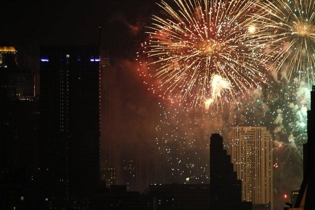 Fireworks explode during New Year celebrations over the city centre of Thailand's capital Bangkok January 1, 2012.