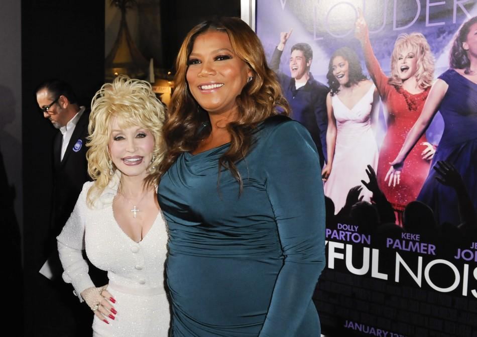 """Cast members Dolly Parton (L) and Queen Latifah (R) arrive at the Hollywood premiere of """"Joyful Noise"""" in Los Angeles, California"""