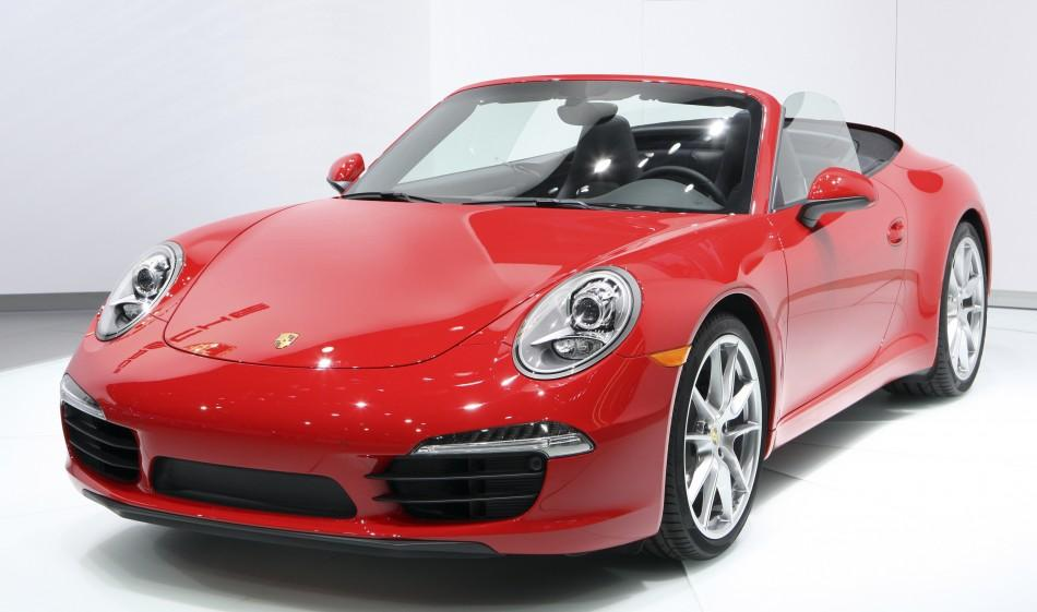 The convertible version of the Porsche 2012 911 Carrera Coupe is displayed during first press preview day for the North American International Auto Show in Detroit, Michigan January 9, 2012.