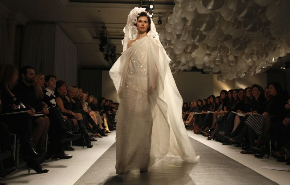 A model presents a creation by Lebanese designer Georges Chakra for his collection of Spring Summer 2012,during a fashion show in Beirut January 18, 2012.