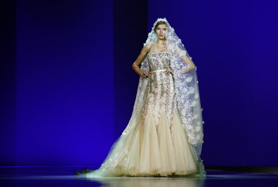 A model presents a creation from Modessa Couture during its 'Shimmering Reflectionzs' show on the second day of Hong Kong Fashion Week Fall/Winter January 17, 2012. Hong Kong Fashion Week, which lasts till January 19, features about 1,900 exhibi