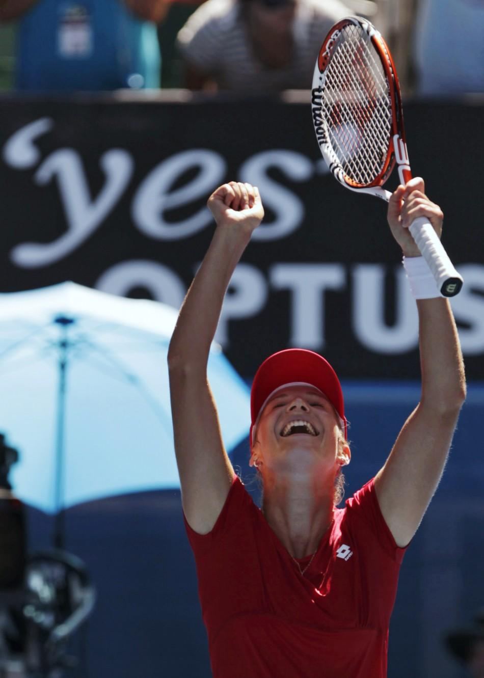 Ekaterina Makarova of Russia celebrates defeating Serena Williams of the U.S. during their women's singles match at the Australian Open tennis tournament