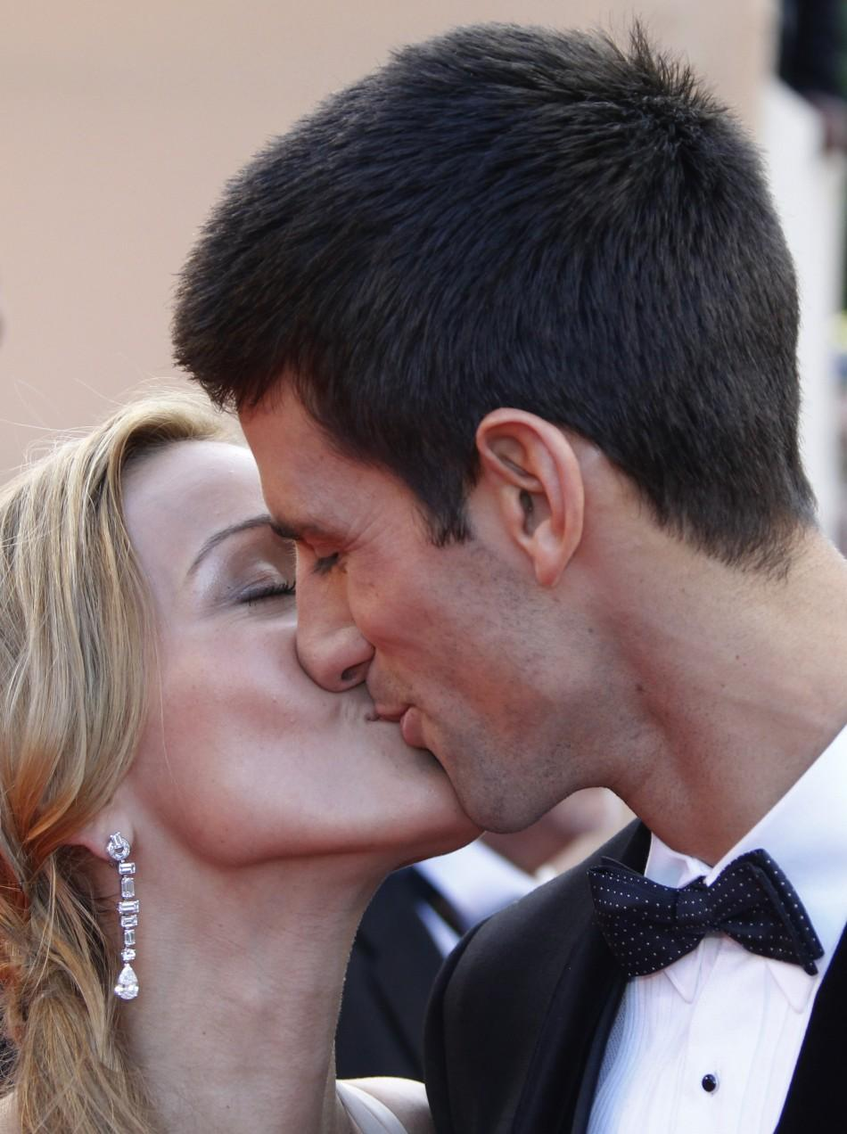 "Serbia's tennis player Novak Djokovic and his girlfriend Jelena Ristic kiss as they arrive on the red carpet for the screening of the film ""The Beaver"" at the 64th Cannes Film Festival, May 17, 2011."