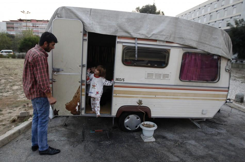 Mateus Silva and his daughters at their Lisbon trailer, before being evicted