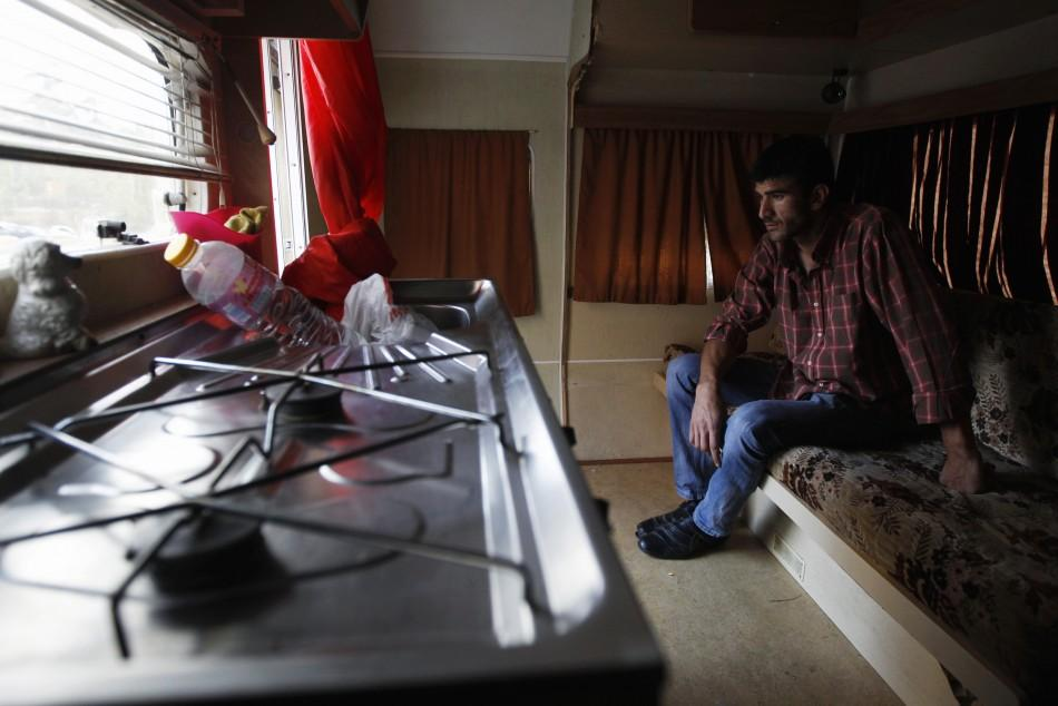 Mateus Silva speaks with a Reuters photographer inside his trailer